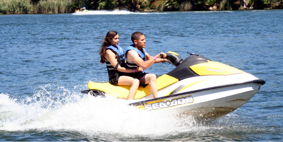 2 teenagers on a jetski